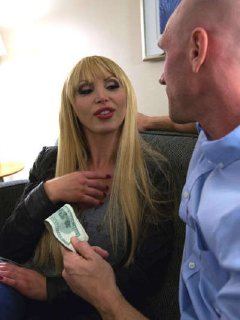 Big titted blonde Nikki Benz gets a facial cumshot