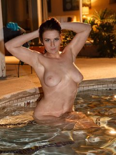 Busty Emmy Sinclair posing in a pool and a shower